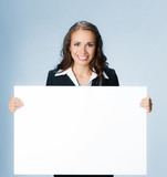 Businesswoman showing signboard, over blue - 184434911