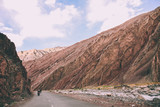 motorcyclists on road between rocky mountains in Indian Himalayas, Ladakh region