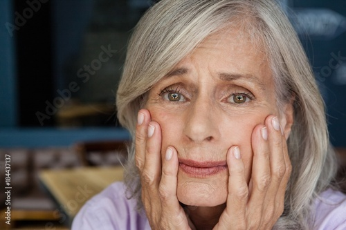Portrait of worried senior woman
