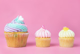 Rainbow pastel cupcakes and mini cupcakes on pink background - 184438365