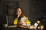 Thoughtful woman at office copy space - 184441114
