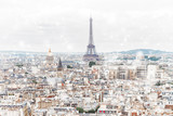 Paris city roofs skyline with Eiffel Tower from above at winter, France