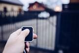 Man opening automatic property gate - 184449752
