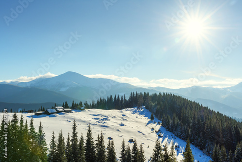 Plexiglas Winter Fantastic landscape with snowy mountains, trees and house. Carpathian mountains, Ukraine, Europe