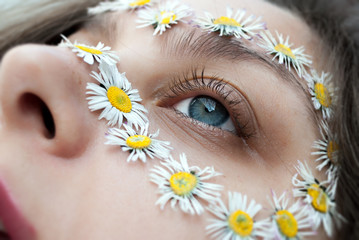 Close up of a face with flowers