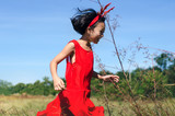 Asian Kids Wearing Reindeer Headband and Running in the Meadow.