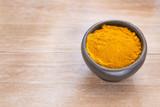 Turmeric powder in the bowl - Curcuma longa - 184501598