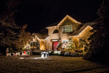 Decorated house for Christmas at night poster