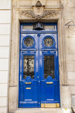 PARIS, FRANCE, on October 30, 2017. The rich decor decorates an entrance door of the old building of traditional architecture of in downtown