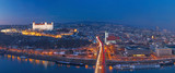 BRATISLAVA, SLOVAKIA, DECEMBER - 1, 2017:  Panoramic skyline of the City from SNP Bridge at dusk. - 184520599