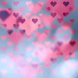 Beautiful blurry heart symbols on abstract bokeh illustration background with place for text.
