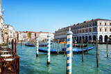 VENICE,ITALY- May 18, 2017 : Tourists on water street with Gondola in Venice. its entirety is listed as a World Heritage Site, along with its lagoon - 184535164