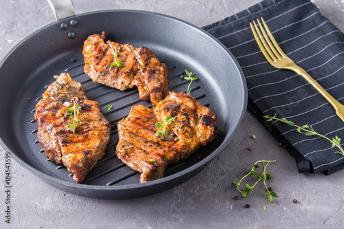Grilled meat with thyme. - 184543595