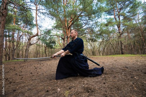 Foto op Canvas Zen Man, in a traditional Japanese clothes, with a sword
