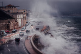 Scary Stormy background with Big Sea Wave Splash Against City Road  - 184550968