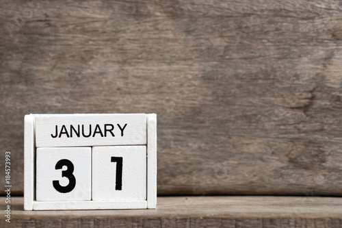 White block calendar present date 31 and month January on wood background Poster