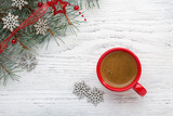 Red cup of coffee and fir branch with Christmas decorations on old wooden shabby background - 184580594
