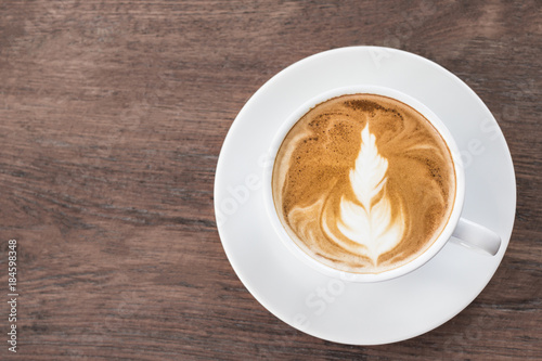 Foto op Canvas Chocolade coffee cup latte art on wooden.copy space for your text