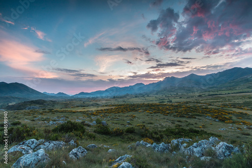 Foto op Aluminium Blauwe jeans colored clouds at sunset in the mountains of Leon, spain