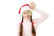 Young girl in santa hat with bauble on white background