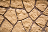 a wall decorated with brown stones - 184626174