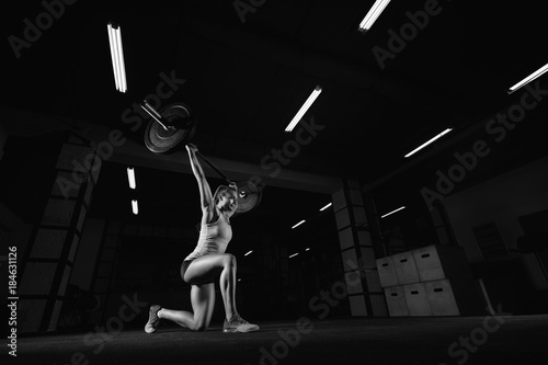 Poster Female fitness athlete exercising