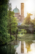 View to park and bridge over river on background of historic building in Treviso, Italy.