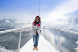 Asian tourists traveling in Europe On the mountain cover Snow  - 184643999