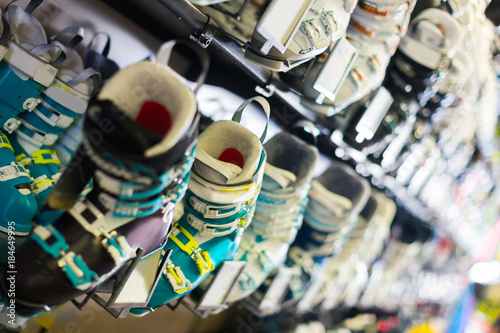 Photography of colorful ski boots on showcase