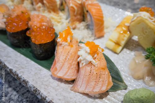 Tuinposter Sushi bar Sushi sashimi and sushi rolls set