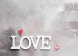 Valentines day background with  white hearts and wooden letters