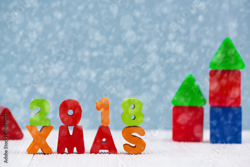 Xmas 2018 colorful wooden text on white wooden desk with Christmas decorations, Merry Christmas and happy new year concept Poster