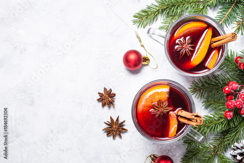 Mulled wine in glass top view copy space.