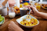 hands of woman eating cereals for breakfast - 184717940