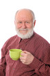 Happy senior man with green cup, isolated on white