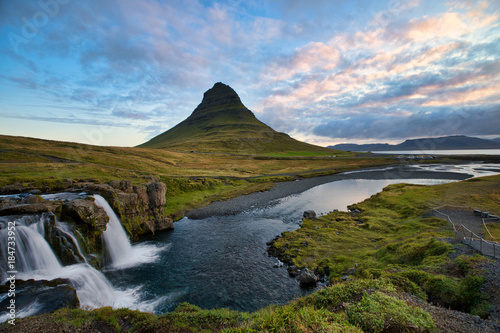 The beautiful sunrise over landscapes and waterfalls. Late evening Kirkjufell volcano the coast of Snaefellsnes peninsula. Location Kirkjufellsfoss, Iceland.