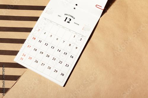 December calendar page on a desk Poster