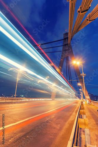 Staande foto Kiev The light trails on the Moscow bridge in Kiev at night
