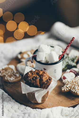 Fotobehang Chocolade Hot chocolate, cookies and muffin in bed. Winter Christmas theme