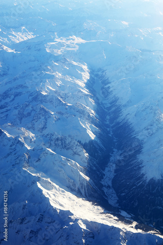Foto op Aluminium Blauwe jeans Aerial view of the Swiss Alps, seen from the plane