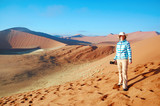 African vacation holiday, woman tourist travels Namib desert dunes and lanscape, Namibia, Africa