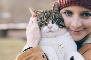 Woman and her cat playing outdoor