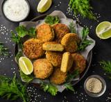 roasted chickpeas falafel patties with garlic yogurt sauce - 184805524