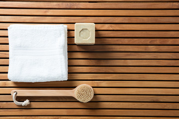 Still life with solid soap, body brush and white towel © STUDIO GRAND WEB