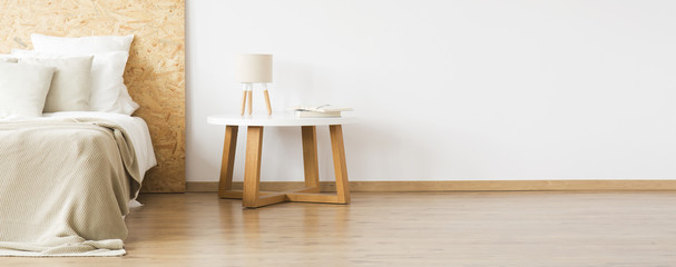 Wooden table in natural bedroom