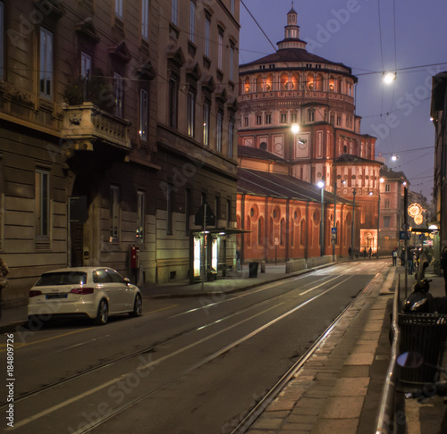 Foto op Canvas Milan a street in Milan during the Christmas period, with the illuminated church, Santa Maria delle Grazie