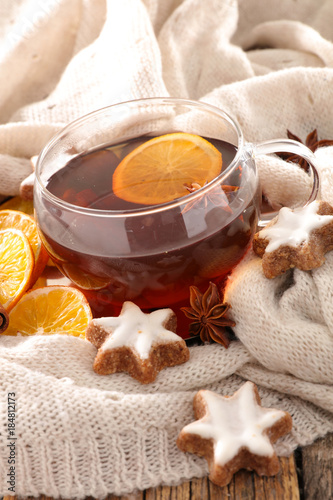 tea cup with orange and cookies