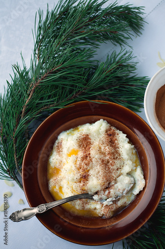 rice porridge traditional christmas breakfast in scandinavia with cinnamon and almonds