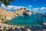 Beautiful St. Paul´s bay with boats, Lindos acropolis in background (Rhodes, Greece) - 184833788