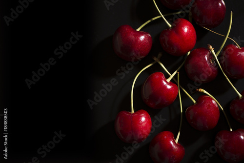 Fotobehang Kersen Raw cherries on black background